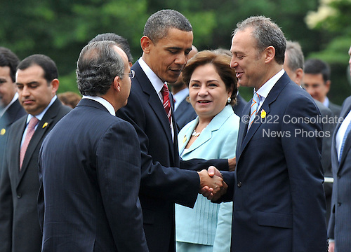 United States President Barack Obama (C) greets members of the Mexican delegation as Mexican President Felipe Calderon (L) stands by during a welcoming ceremony on the South Lawn of the White House in Washington on Wednesday, May 19, 2010. .Credit: Kevin Dietsch - Pool via CNP