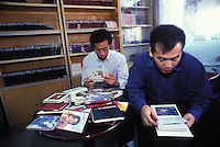 Unmarried men look at books of women for potential brides at the Heart to Heart Dating Agency in Guangzhou, China. An average gender inbalance 118 males to 100 females caused by the Chinese Governments One Child Policy and the  preference for boys means that there is a shortage of women in China.