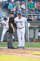 Everett AquaSox manager Dave Valle #10 discusses a call with home plate umpire Mike Goebel during a game against the Salem-Keizer Volcanoes at Everett Memorial Stadium in Everett, Washington on July 9, 2014.  Salem-Keizer defeated Everett 6-4.  (Ronnie Allen/Four Seam Images)
