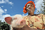 A woman with her pig in Zombwe, Malawi.