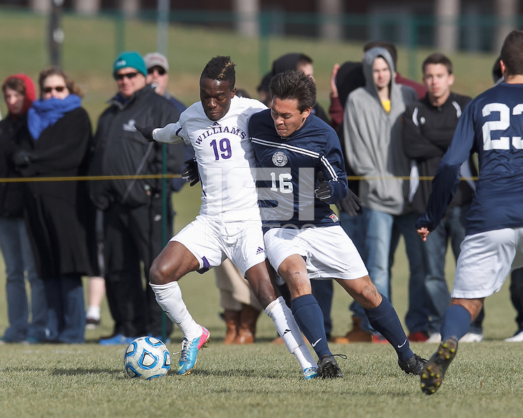 Williams forward Mohammed Rashid (19) attempts to control the ball as Brandeis defender Josh Hacunda (16) defends. NCAA Division III Sectionals. Williams College (white) defeated Brandeis University (blue/white), 2-0, on Hitchcock Field at Amherst College on November 23, 2013.