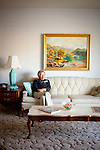 Molly Sheridan, a museum docent, sits in the living room of one of the original model homes, which is now the Del Webb Sun Cities Museum, in Sun City, Arizona dates back to its opening day January 1, 1960.