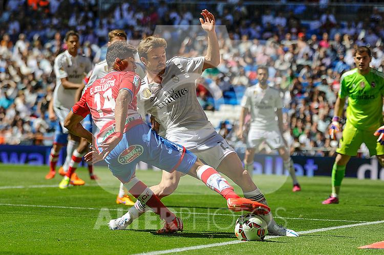 Real Madrid´s Asier Illarramendi and Granada´s Eddy Pascual during 2014-15 La Liga match between Real Madrid and Granada at Santiago Bernabeu stadium in Madrid, Spain. April 05, 2015. (ALTERPHOTOS/Luis Fernandez)