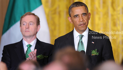 United States President Barack Obama speaks as Prime Minister Enda Kenny of Ireland looks on during a reception in the East Room of the White House in Washington, D.C., March 19, 2013 in Washington, DC. <br /> Credit: Olivier Douliery / Pool via CNP