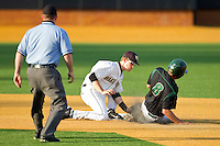 Shortstop Jack Fischer #15 of the Wake Forest Demon Deacons puts the tag on Shane Basen #8 of the Charlotte 49ers as he tries to steal second base at Gene Hooks Field on March 22, 2011 in Winston-Salem, North Carolina.  Photo by Brian Westerholt / Four Seam Images