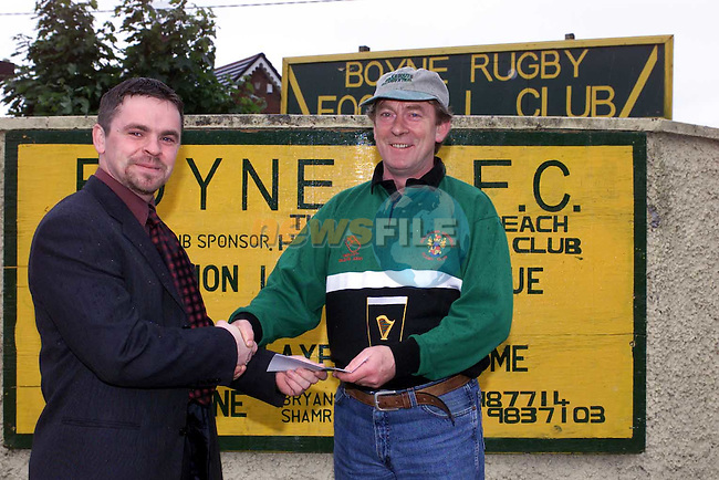Brendan Clinton of Dublin Providers Ltd presents a chaque to Michael Quinn of Boyne RFC for the Blitz.Picture Fran Caffrey Newsfile