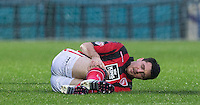 Peter Murphy of Morecambe goes down injured and is later stretchered off during the Sky Bet League 2 match between Wycombe Wanderers and Morecambe at Adams Park, High Wycombe, England on 2 January 2016. Photo by Andy Rowland / PRiME Media Images