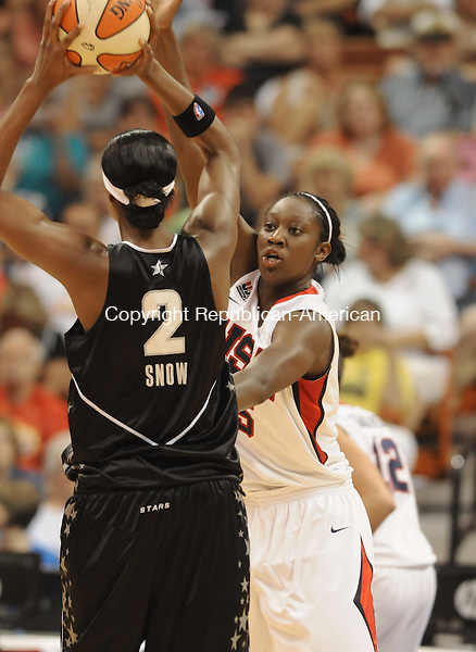 UNCASVILLE, CT 10  JULY, 2010-071010JS05-Team USA's Tina Charles (15) plays tight defense on WNBA All-Star Michelle Snow (2) of the San Antonio Silver Stars during their game Saturday at the Mohegan Sun Arena in Uncasville. <br /> Jim Shannon Republican-American