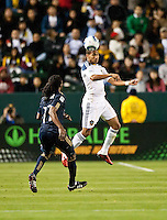 CARSON, CA – April 2, 2011: LA Galaxy defender Sean Franklin (5) goes up to head the ball during the match between LA Galaxy and Philadelphia Union at the Home Depot Center, March 26, 2011 in Carson, California. Final score LA Galaxy 1, Philadelphia Union 0.