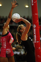 Geva Mentor tries to block Irene Van Dyk's shot from behind during the International  Netball Series match between the NZ Silver Ferns and World 7 at TSB Bank Arena, Wellington, New Zealand on Monday, 24 August 2009. Photo: Dave Lintott / lintottphoto.co.nz