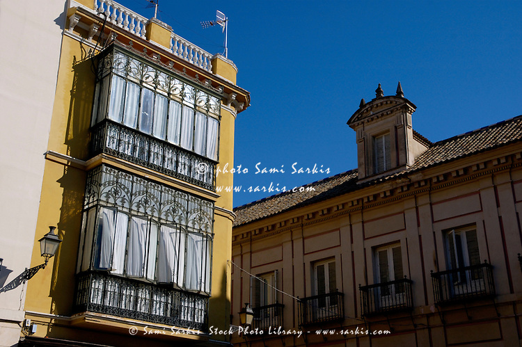 Traditional building with bow windows, Barrio Santa Cruz, Seville, Andalusia, Spain.