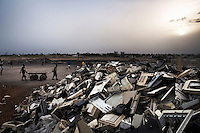 Plastic from e-waste is piled high at Agbogbloshie dump, which has become a dumping ground for computers and electronic waste from all over the developed world. Hundreds of tons of e-waste end up here every month. It is broken apart, and those components that can be sold on, are salvaged.