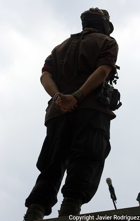 Zapatista rebel leader Subcomandante Marcos, the Delegado Zero, stands up during a rally at the Plaza de las 3 Culturas main square in Tlatelolco, May 3, 2006. Subcomandante Marcos addressed a speech before hundreds of people and declared a red alert after the San Salvador Atenco peasants clashed with police in Texcoco city, in Mexico State. More than 90 people were arrested during the clashes. Photo by Javier Rodriguez