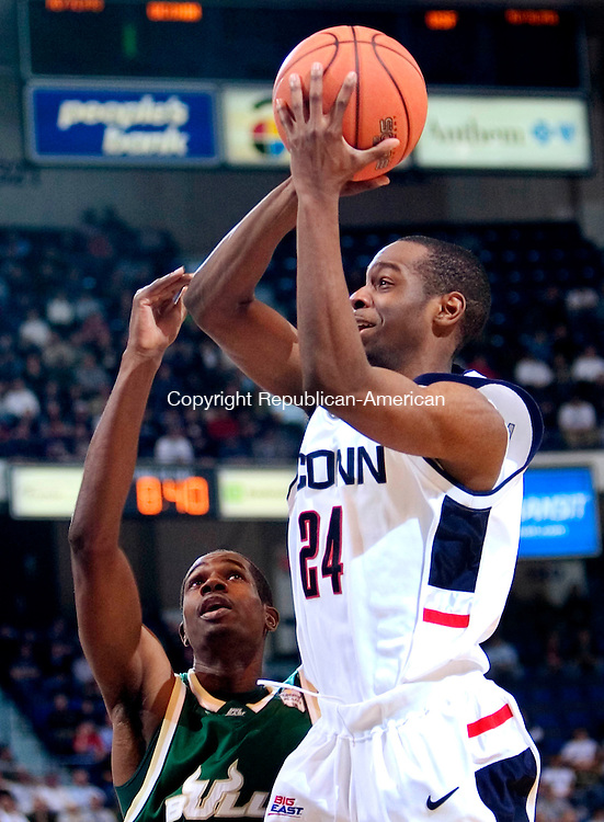 HARTFORD, CT. 02 January 2007-010207SV08--#24 Craig Austrie of UConn goes up for a shot as #15 McHugh Mattis of South Florida defends during basketball action at the Civic Center in Hartford Tuesday. <br /> Steven Valenti / Republican-American