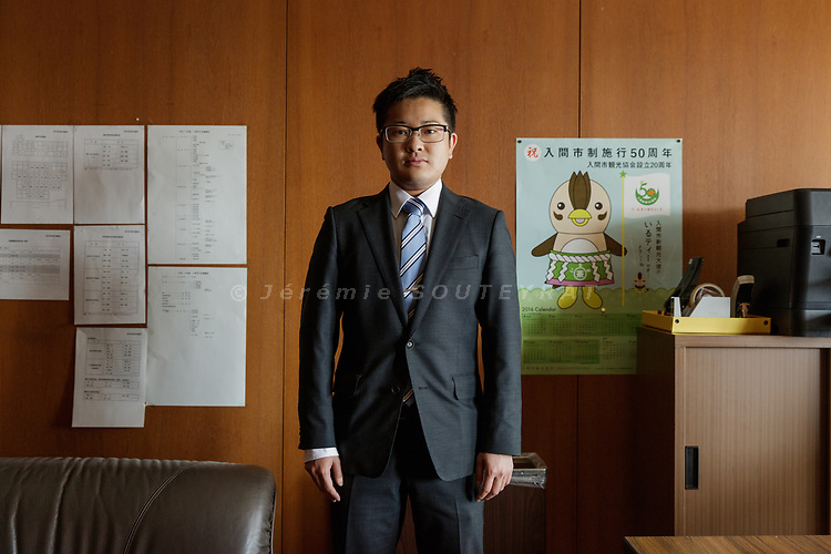 Iruma city, Saitama prefecture, Japan, April 14 2017 - Portrait of Tomoya HOSODA in his office at the Iruma city hall. <br /> Tomoya HOSODA is the first out transgender man to be elected to a public office. He was elected a councillor in the city of Iruma in March 2017. Mr Hosoda officially changed his name and gender in the family registry in 2015 after having come out and transitioned.