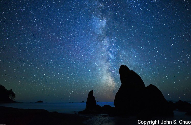 Milky Way & 2 shooting stars pass over silhouetted sea stacks at Ruby Beach, Olympic National Park, Washington State.