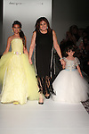 Fashion designer Wanda Beauchamp walks runway with child models at the close of her Wanda Beauchamp Girls Couture collection fashion show, for the Designer's Collective Spring Summer 2017 fashion show during Fashion Gallery New York Fashion Week Spring Summer 2017 on September 10, 2016.