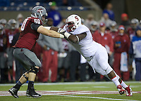 SEATTLE, WA - September 28, 2013: Stanford defensive tackle Ikenna Nwafor is blocked by Washington State offensive linesman Elliott Bosch during play at CenturyLink Field. Stanford won 55-17