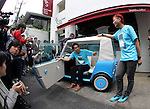 "May 20, 2016, Tokyo, Japan - Japanese automobile venture rimOnO president Shinsuke Ito (C) and car designer Kota Nezu (R) display the prototype model of the electric powered personal mobility ""rimOnO"" in Tokyo on Friday, May 20, 2016. The rimOnO, 2m in length and 1m wideth, is equipped with in-wheel motors to drive two seater light weight body which is made by soft materials.  (Photo by Yoshio Tsunoda/AFLO) LWX -ytd-"