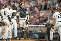 Michigan Wolverines catcher Joe Donovan (0) waits on the mound for head coach Erik Bakich (23) against the Vanderbilt Commodores during Game 2 of the NCAA College World Series Finals on June 25, 2019 at TD Ameritrade Park in Omaha, Nebraska. Vanderbilt defeated Michigan 4-1. (Andrew Woolley/Four Seam Images)