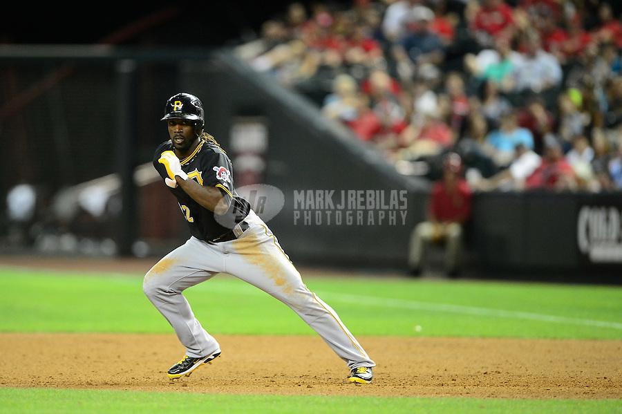 Apr. 17, 2012; Phoenix, AZ, USA; Pittsburgh Pirates outfielder (22) Andrew McCutchen steals second base against the Arizona Diamondbacks at Chase Field. Mandatory Credit: Mark J. Rebilas-