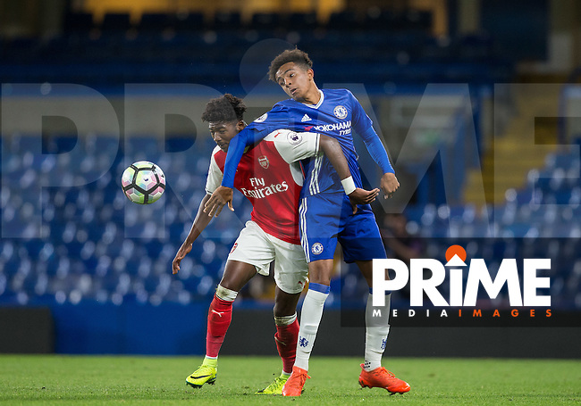 Jacob Maddox of Chelsea and Ainsley Maitland-Miles of Arsenal battle for the ball during the EPL2 - U23 - Premier League 2 match between Chelsea and Arsenal at Stamford Bridge, London, England on 23 September 2016. Photo by Andy Rowland.
