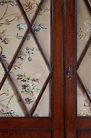 Detail of floral backing on a Georgian wardrobe in the twin bedroom