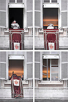 The last Angelus of Pope Benedict XVI,the Secretaries of the Pope withdraw large red cloth with the papal coat of arms and close the window, Pope Benedict XVI leads the Angelus prayer from the window of his appartmnents on February 24, 2013 at the Vatican.