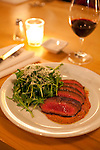 Laurelhurst Market where during the day a butcher shop offers fresh, all natural meats and at night, a full service restaurant featuring local, fresh ingredients. The Steak and Arugula Salad with ancho romesco.