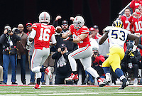 Ohio State Buckeyes quarterback J.T. Barrett (16) throws a pass to Ohio State Buckeyes tight end Nick Vannett (81) as he runs into the end zone to score in the first quarter the college football game between the Ohio State Buckeyes and the Michigan Wolverines at Ohio Stadium in Columbus, Saturday morning, November 29, 2014. As of half time the Ohio State Buckeyes and Michigan Wolverines were tied 14 - 14. (The Columbus Dispatch / Eamon Queeney)
