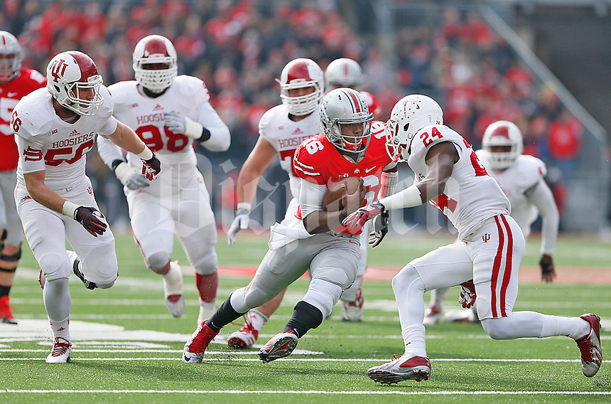 Ohio State Buckeyes quarterback J.T. Barrett (16) cuts through the Indiana defense for a first half gain at Ohio Stadium on 22, 2014. (Chris Russell/Dispatch Photo)