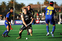 NZ's Steve Edwards takes the ball past Hafifi Hafiz Hanafi during the international hockey match between the New Zealand Black Sticks and Malaysia at Fitzherbert Park, Palmerston North, New Zealand on Sunday, 9 August 2009. Photo: Dave Lintott / lintottphoto.co.nz