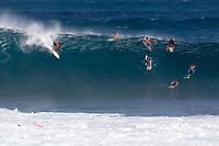 A surfer drops in on a big wave at Pipeline (off of 'Ehukai Beach Park), North Shore, O'ahu.