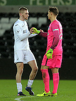 Pictured L-R: Oli Mcburnie of Swansea greets Nils Koerber of Hertha Berlin Tuesday 28 February 2017<br /> Re: Premier League International Cup, Swansea City U23 v Hertha Berlin II at at the Liberty Stadium, Swansea, UK