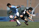 11 September 2005: Michael Callahan (5) gets past Eric Szeszycki (3). The University of North Carolina Tarheels defeated the University of South Carolina Gamecocks 2-0 in an NCAA Divison I men's soccer game at Fetzer Field in Chapel Hill, NC.