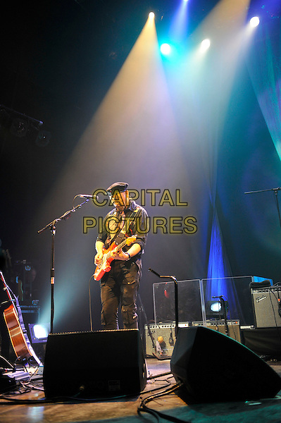 Richard Thompson.performing in concert, Shepherd's Bush Empire, London, England. .25th February 2013.on stage lie gig performance music length hat flat cap scarf black shirt full side profile guitar goatee facial hair .CAP/MAR.© Martin Harris/Capital Pictures.