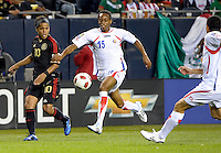 Costa Rica's Junior Diaz attempts to beat Mexico's Giovani dos Santos to the ball.  Mexico defeated Costa Rica 4-1 at the 2011 CONCACAF Gold Cup at Soldier Field in Chicago, IL on June 12, 2011.
