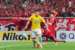 Jiangsu FC Forward Roger Beyker Martinez (L) fights for the ball with Shanghai FC Defender He Guan (R) during the AFC Champions League 2017 Round of 16 match between Shanghai SIPG FC (CHN) vs Jiangsu FC (CHN) at the Shanghai Stadium on 24 May 2017 in Shanghai, China. Photo by Marcio Rodrigo Machado / Power Sport Images