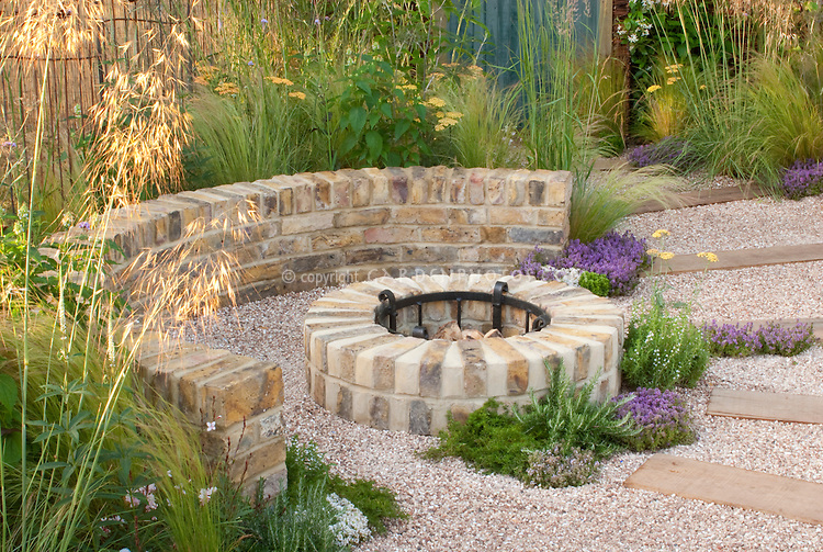 Garden Firepit Fireplace Of Brick, With Pebble Patio In Circular With  Pathway, Wall,
