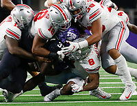 From left, Ohio State Buckeyes defensive end Tyreke Smith (11), Ohio State Buckeyes defensive end Jonathon Cooper (18), Ohio State Buckeyes linebacker Malik Harrison (39) and Ohio State Buckeyes cornerback Kendall Sheffield (8) bring down TCU Horned Frogs running back Sewo Olonilua (33) during the third quarter of a NCAA Division I college football game between the TCU Horned Frogs and the Ohio State Buckeyes on Saturday, September 15, 2018 at AT&T Stadium in Arlington, Texas. [Joshua A. Bickel/Dispatch]