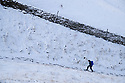 28/01/120<br /> <br /> A hiker makes her way up a snowy trail on Mam Tor, near Castleton in the Derbyshire Peak District..<br /> <br /> <br /> All Rights Reserved: F Stop Press Ltd.  <br /> +44 (0)7765 242650 www.fstoppress.com