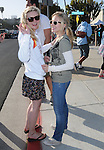 "Kristen Bell & Kirsten Dunst at The Invisible Children's ""THE RESCUE"" Rally at City Hall in Santa Monica, California on April 25,2009                                                                     Copyright 2009 DVS / RockinExposures"