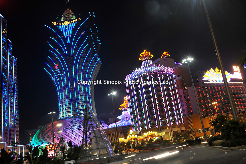 "The Grand Lisboa (left) and Casino Lisboa (right) light up the main boulevard and centre of Macau. Macau is known simply as ""Vegas"" in China. The former Portuguese colony, now a Chinese Special Administrative Region, attracts millions of Chinese gamblers annually and last year earned more gambling dollars than Las Vegas.."