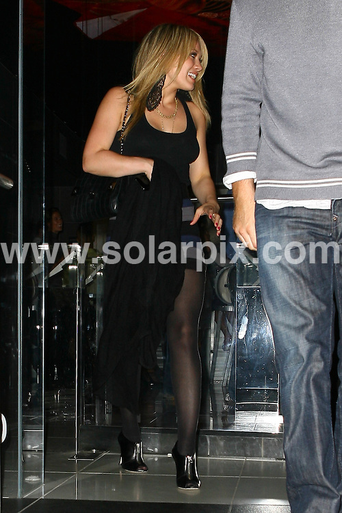 **ALL ROUND PICTURES FROM SOLARPIX.COM**.**SYNDICATION RIGHTS FOR UK AND SPAIN ONLY**.Hillary Duff and boyfriend Mike Comrie enjoy a late night dinner at Katsuya Restaurant in Hollywood, California, USA. 14th August 2008..This pic: Hillary Duff..JOB REF: 7023 LAP/Lancer        DATE: 14_08_2008.**MUST CREDIT SOLARPIX.COM OR DOUBLE FEE WILL BE CHARGED* *UNDER NO CIRCUMSTANCES IS THIS IMAGE TO BE REPRODUCED FOR ANY ONLINE EDITION WITHOUT PRIOR PERMISSION*