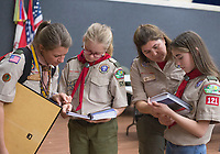 NWA Democrat-Gazette/CHARLIE KAIJO Amanda and Annabella Tyburski (from left) and Ruby and Annabella Freeman (from right) look at through the Scouts BSA manual during a family scouting open house, Monday, February 4, 2019 at First United Methodist Church in Bentonville.