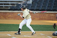Jonathan Pryor (11) of the Wake Forest Demon Deacons follows through on his swing against the UConn Huskies at Wake Forest Baseball Park on March 17, 2015 in Winston-Salem, North Carolina.  The Demon Deacons defeated the Huskies 6-2.  (Brian Westerholt/Four Seam Images)