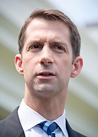 United States Senator Tom Cotton (Republican of Arkansas) speaks to reporters outside the White House after meeting US President Donald J. Trump to discuss his proposed legislation to enact a skills-based immigration system called the Reforming American Immigration for a Strong Economy (RAISE) Act that they claim would also result in a lower level of immigration. Photo Credit: Ron Sachs/CNP/AdMedia