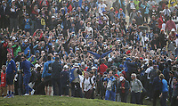 Scene at the 16th. Tommy Fleetwood (Team Europe) celebrates his win with the gallery during Sunday's Singles, at the Ryder Cup, Le Golf National, Île-de-France, France. 30/09/2018.<br /> Picture David Lloyd / Golffile.ie<br /> <br /> All photo usage must carry mandatory copyright credit (© Golffile | David Lloyd)