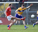Conor Grimes of Louth  in action against Cillian Brennan of Clare during their national League game in Cusack Park. Photograph by John Kelly.