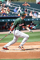 Zack Collins (0), designated hitter for the University of Miami Hurricanes, during a spring training game against the Miami Marlins at the Roger Dean Complex in Jupiter, Florida on March 3, 2015. Miami defeated UM 7-1. (Stacy Jo Grant/Four Seam Images)
